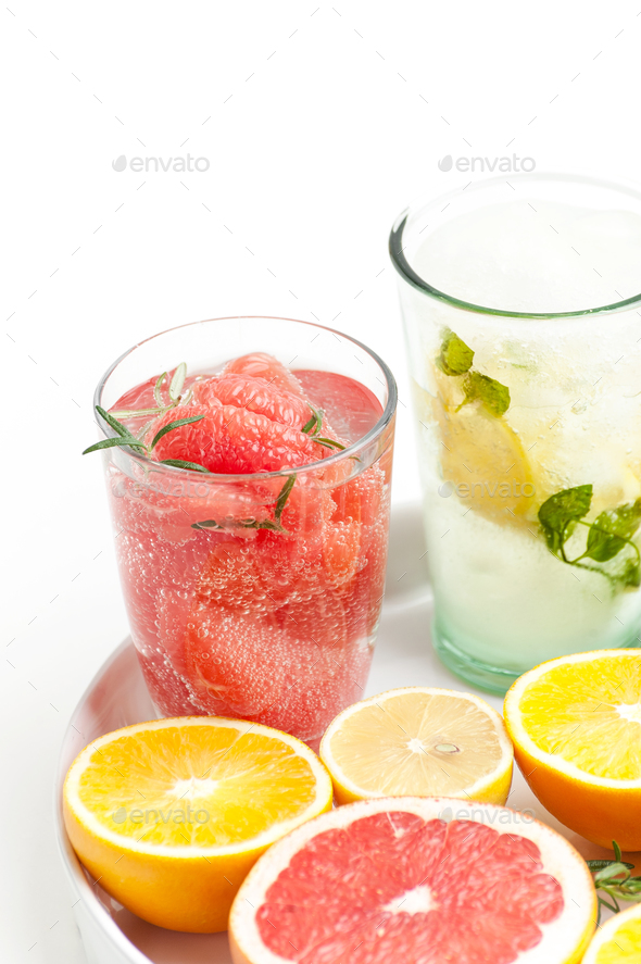 A glass of lemonade with grape-cucumber slices and lemon on a wh - Stock Photo - Images
