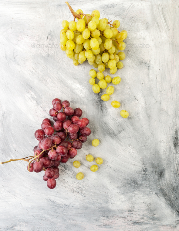 White and red grapes on a gray old table. - Stock Photo - Images