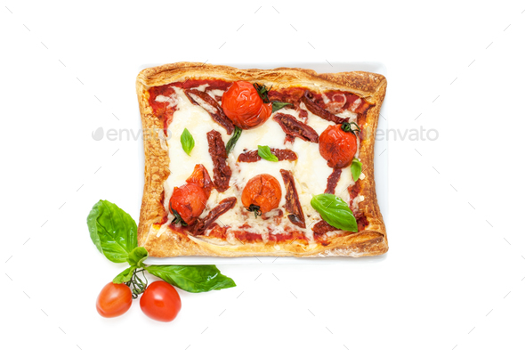 Square pizza in a country style with dried tomatoes, mozzarela a - Stock Photo - Images