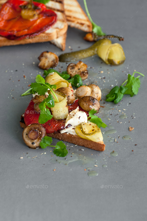 Toast with mild cheese, pepper grilled and fried paddles on a gr - Stock Photo - Images