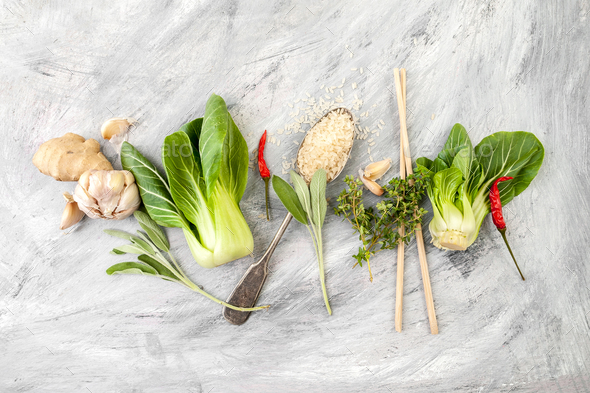 Salad Pak-choi (Chinese cabbage), rice and seasonings on a light - Stock Photo - Images