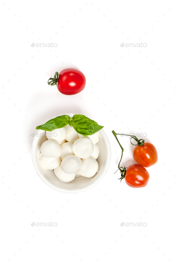 Ripe cherry tomatoes and Mozzarella cheese on a clean white back - Stock Photo - Images