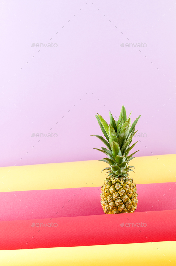 Pineapple on a combined colored background with free space for t - Stock Photo - Images
