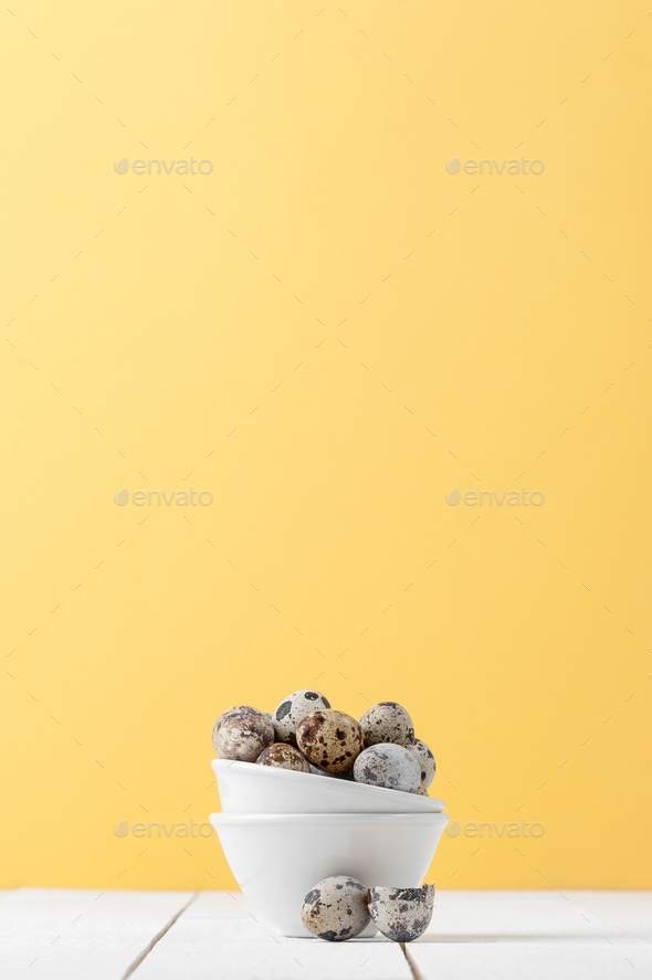 Minimalistic still life: fresh sawed eggs in a miniature white b - Stock Photo - Images