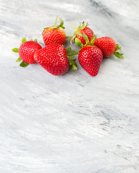 Ripe strawberries on an old gray table. Photo with negative spac - Stock Photo - Images