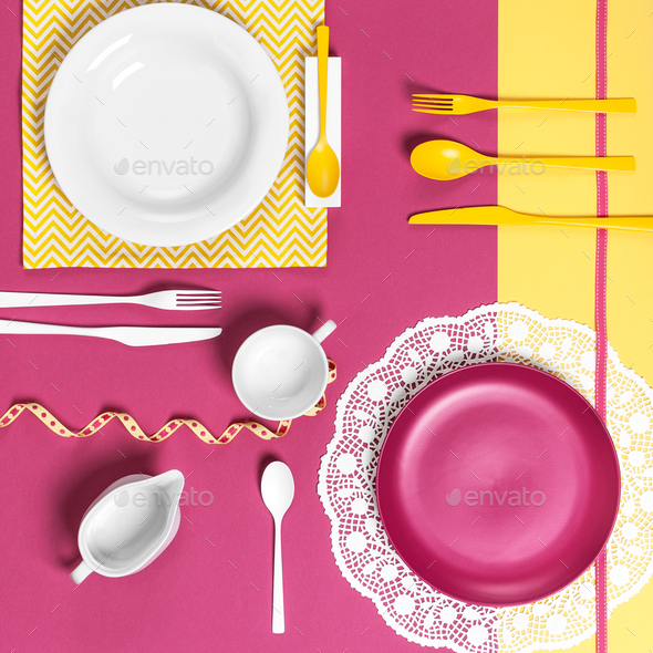 Serving dishes on a yellow pink background. - Stock Photo - Images