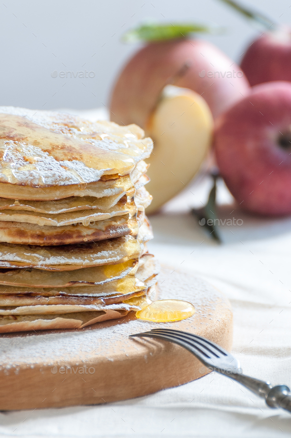 Apple pancakes with honey on a wooden board. - Stock Photo - Images