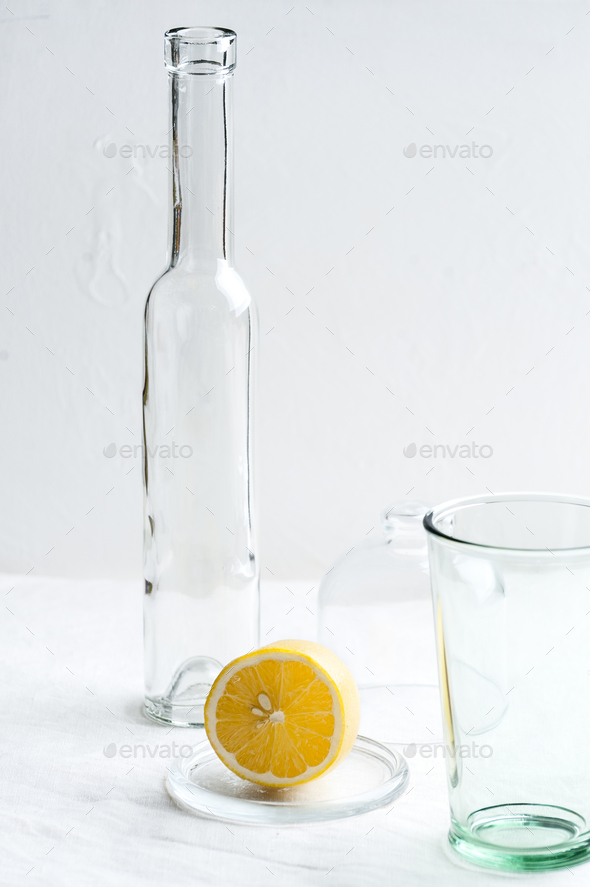 Glassware and half a lemon. Conceptual food photo. - Stock Photo - Images