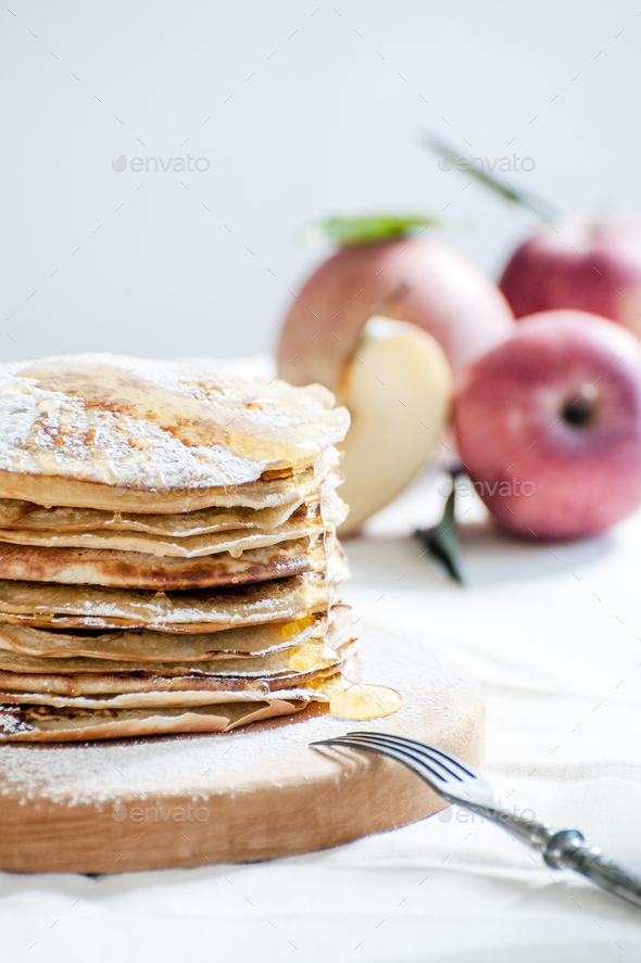 Russian traditional dish - apple pancakes with honey. - Stock Photo - Images