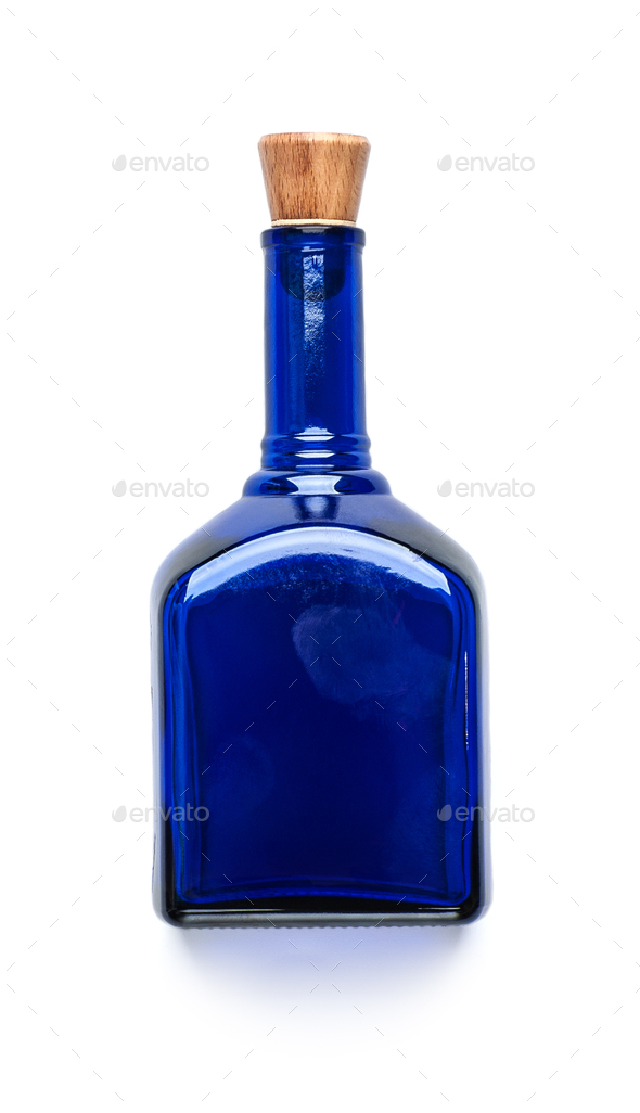 Blue glass bottle with a wooden lid on a clean white background. - Stock Photo - Images