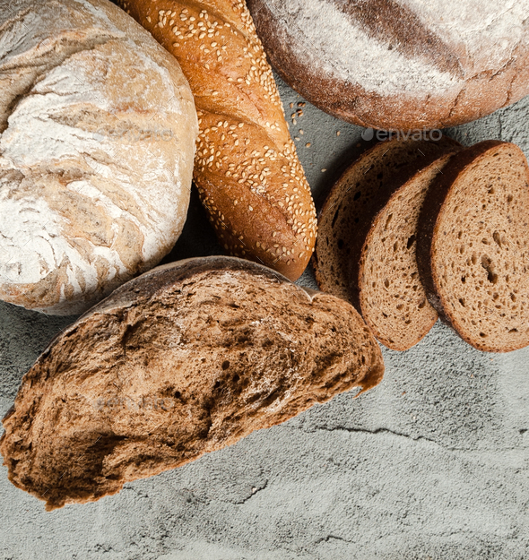 Different types of bread on the concrete top. - Stock Photo - Images