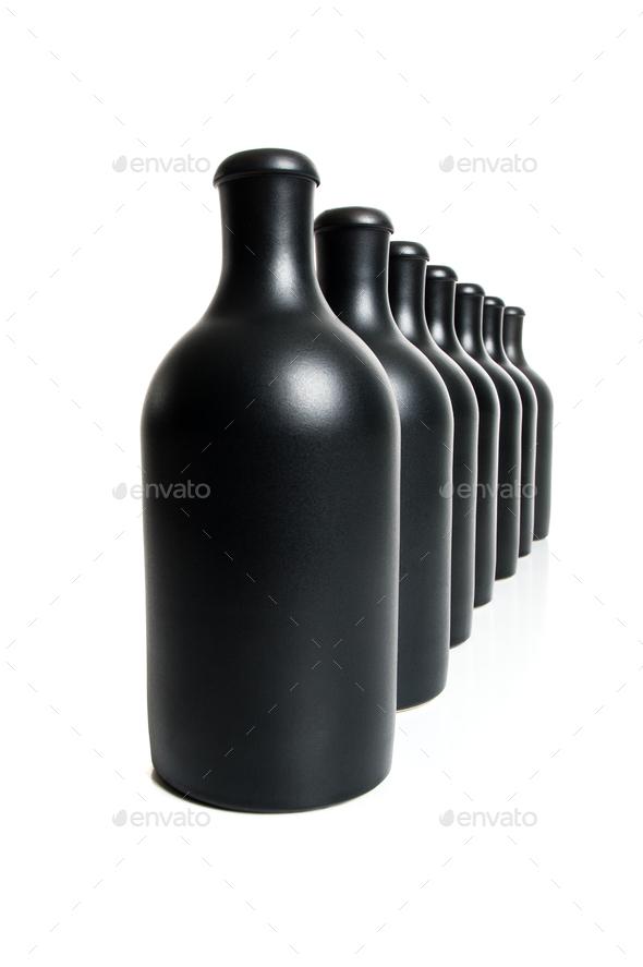 Set of several matte black bottles on a white background. - Stock Photo - Images