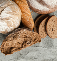 Different types of bread on the concrete top. - PhotoDune Item for Sale