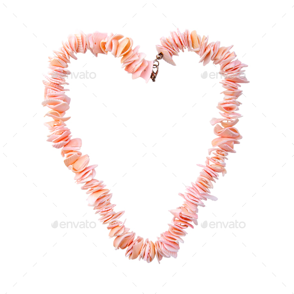 Coral beads in the shape of a heart on a pure white background. - Stock Photo - Images