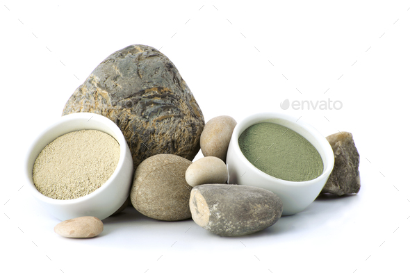 White and green cosmetic clay beside the stones on a white backg - Stock Photo - Images