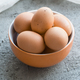 Brown chicken eggs in a bowl on a gray stone table. - PhotoDune Item for Sale