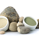 White and green cosmetic clay beside the stones on a white backg - PhotoDune Item for Sale