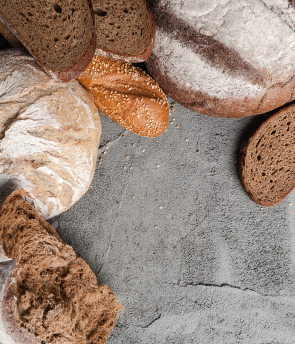 Different types of bread on the concrete top with a place for te - Stock Photo - Images