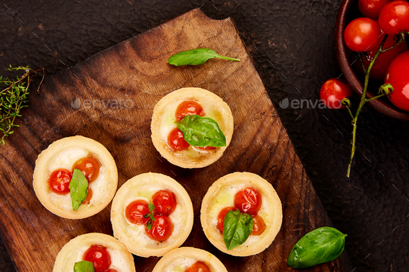 Mini tarts with cherry tomatoes - Stock Photo - Images