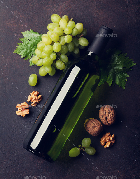 Wine bottle, grape and nuts - Stock Photo - Images