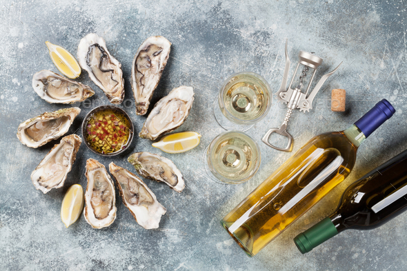 Fresh oysters and white wine - Stock Photo - Images