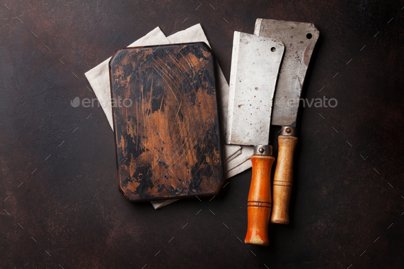 Butcher. Vintage meat knives and board - Stock Photo - Images
