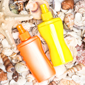 Sunscreen cosmetic products with shells and starfish - PhotoDune Item for Sale