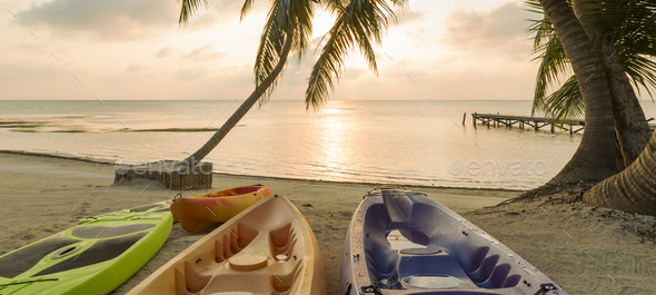 Beach Sunrise With Kayaks - Stock Photo - Images