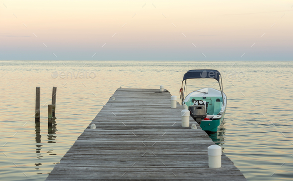 Boat And Jetty At Sunrise - Stock Photo - Images