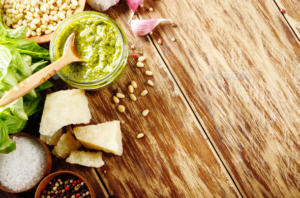 Top view of Pesto sauce and ingredients on wood table with copy- - Stock Photo - Images