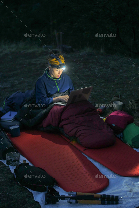 camping laptop at night - Stock Photo - Images