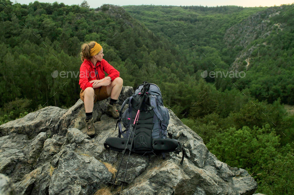 caucasian hiker standing on a rocky peak - Stock Photo - Images