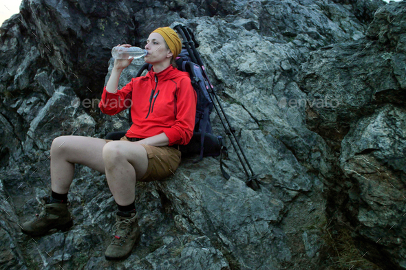 female hiker drinking water - Stock Photo - Images