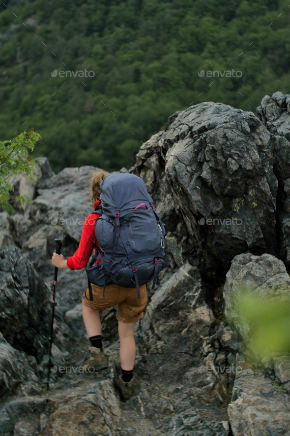 female hiker walking on a trail - Stock Photo - Images