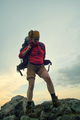 hiker putting on a backpack - PhotoDune Item for Sale
