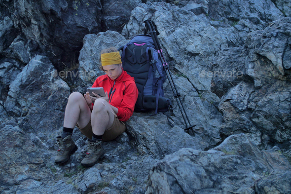 hiker using portable tablet technology - Stock Photo - Images