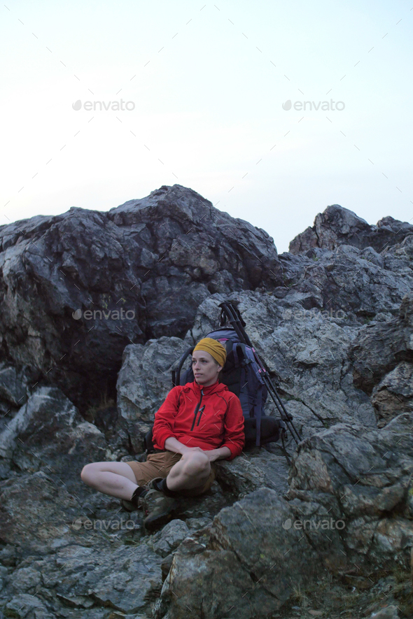 hiker resting on trail - Stock Photo - Images