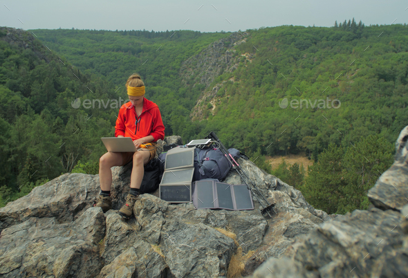 solar charging hiker - Stock Photo - Images