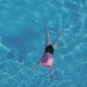 Young Woman Swimming in a Swimming Pool - VideoHive Item for Sale
