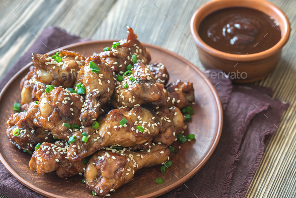1Chicken teriyaki wings with barbecue sauce - Stock Photo - Images