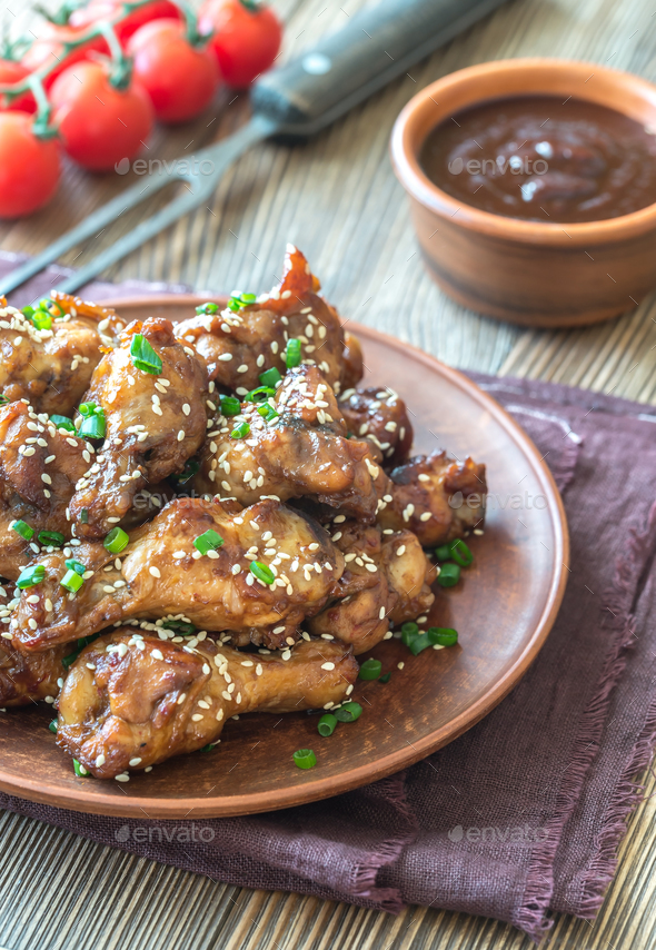 Chicken teriyaki wings with barbecue sauce - Stock Photo - Images