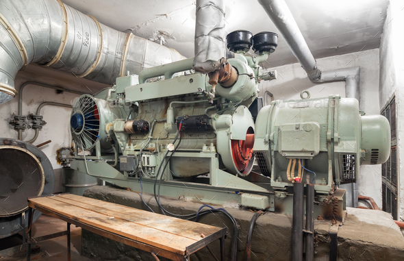 Big old diesel generator inside an shelter - Stock Photo - Images