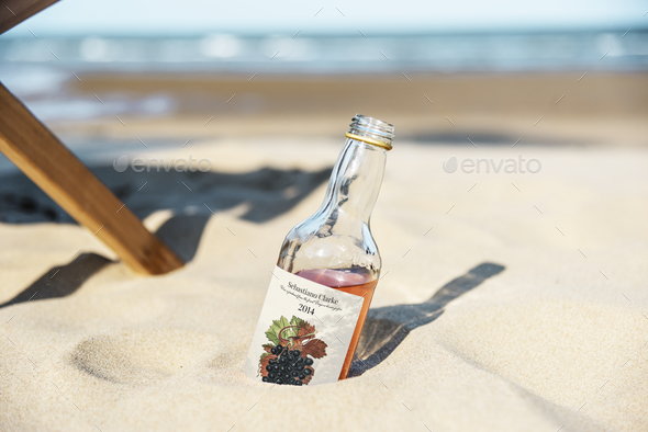 Alcoholic drink in the sand - Stock Photo - Images