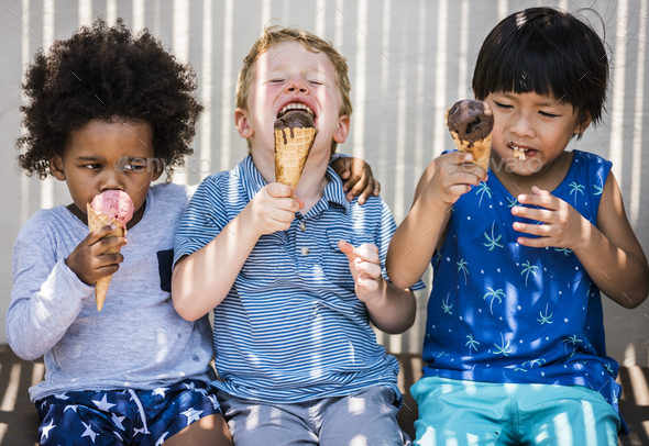 Children enjoying with ice cream - Stock Photo - Images