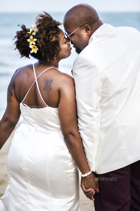 African American couple getting married at the beach - Stock Photo - Images