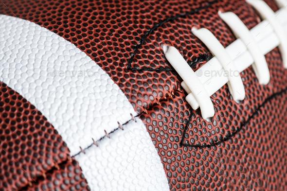 Macro shot of American football ball background - Stock Photo - Images