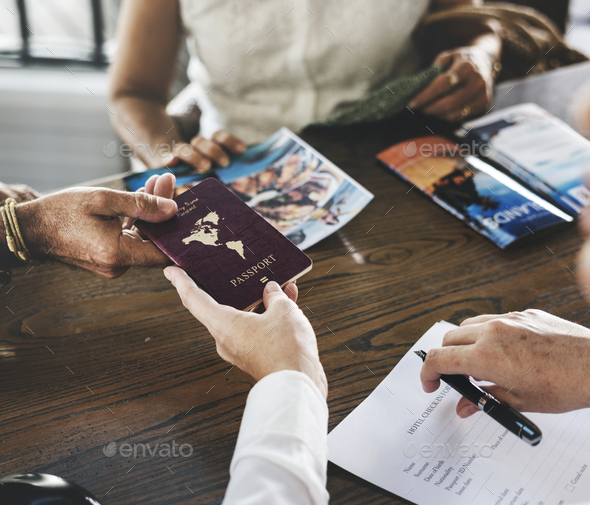 Guest booking a tour at a hotel - Stock Photo - Images