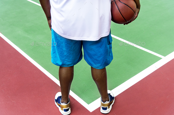 Man on a basketball court - Stock Photo - Images