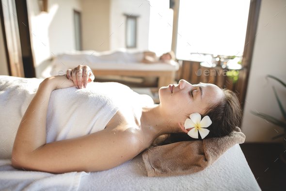 Caucasian woman relaxing with herbal massage - Stock Photo - Images