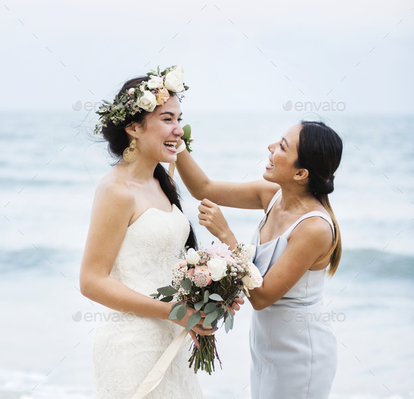 Cheerful bride at the beach - Stock Photo - Images